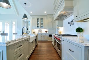 Traditional Kitchen with built-in microwave, French doors, full backsplash, Farmhouse sink, double oven range, can lights