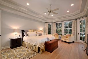 Traditional Master Bedroom with Artemis clear lead crystal table lamp with off-white shade, Crown molding, Ceiling fan
