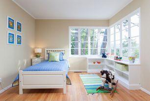 Traditional Kids Bedroom with Built-in bookshelf, Indoor/Outdoor Luau Multi Stripes Rug, Laminate floors, Crown molding