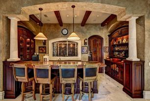 Mediterranean Bar with Pendant light, Built-in bookshelf, Exposed beam, limestone tile floors, Columns, specialty door
