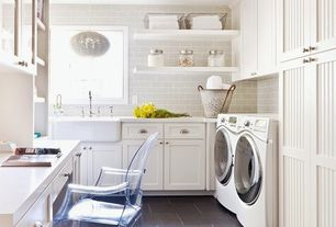 Cottage Laundry Room with Casper dining armchair in clear, Recessed beadboard panel cabinets, Pendant light, Farmhouse sink