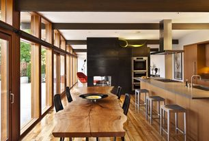 Rustic Dining Room with Hardwood floors, Hudson Furniture English Windsor Dining Table, Glass panel door, Exposed beam