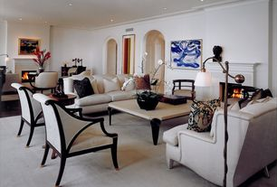 Contemporary Living Room with Crown molding, Carpet, Cement fireplace