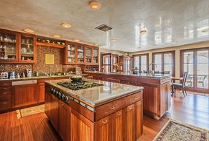 Craftsman Kitchen with French doors, U-shaped, Flat panel cabinets, European Cabinets, Flush, Simple granite counters