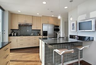 Contemporary Kitchen with electric cooktop, sliding glass door, built-in microwave, Kitchen island, full backsplash, Flush