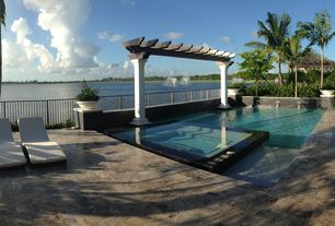 Contemporary Swimming Pool with Pathway, exterior stone floors, Pool with hot tub, Trellis, Fence