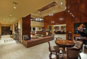 Great Room with Built-in bookshelf, picture window, Cathedral ceiling, Loft, Concrete tile , can lights, French doors