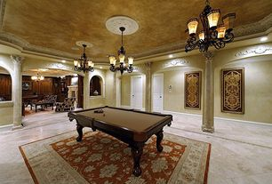Traditional Game Room with can lights, Chandelier, Standard height, specialty door, Concrete tile , Columns