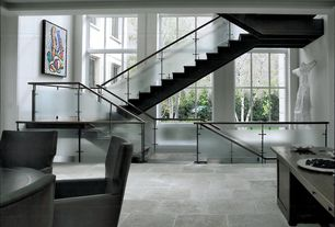 Contemporary Staircase with curved staircase, picture window, Concrete tile , High ceiling