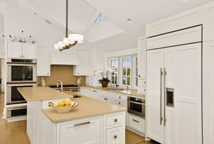 Modern Kitchen with full backsplash, Undermount sink, electric cooktop, Inset cabinets, Custom hood, Casement, wall oven