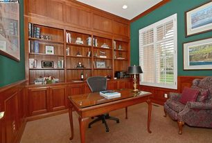 Traditional Home Office with Crown molding, Carpet, Built-in bookshelf, Wainscotting