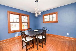 Craftsman Dining Room with Chandelier, Hardwood floors