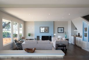 Contemporary Living Room with Fireplace, can lights, Cement fireplace, Standard height, Hardwood floors, specialty window