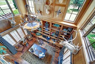 Rustic Home Office with High ceiling, Chandelier, Hardwood floors, Built-in bookshelf