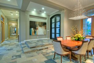 Contemporary Dining Room with French doors, Pendant light, Crown molding, complex marble tile floors, Arched window