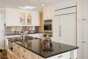 Traditional Kitchen with Kitchen island, Flat panel cabinets, Flush, Absolute black granite, Stainless steel subway tile