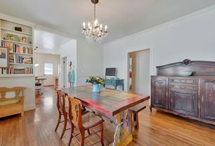 Eclectic Dining Room with Standard height, Hardwood floors, Built-in bookshelf, Chair rail, Chandelier, Crown molding
