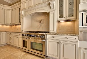Traditional Kitchen with Subway Tile, Raised panel, Custom hood, Simple granite counters, L-shaped, Glass panel