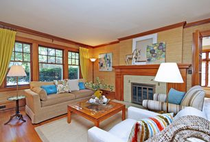 Craftsman Living Room with Fireplace, Crown molding, double-hung window, French doors, brick fireplace, Hardwood floors