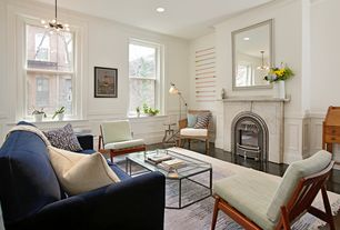 Contemporary Living Room with Hardwood floors, stone fireplace, Crown molding, Wainscotting