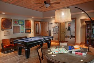 Craftsman Game Room with can lights, Standard height, flush light, specialty door, Ceiling fan, Laminate floors