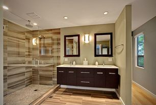 Contemporary Master Bathroom with Standard height, double-hung window, Wall sconce, Double sink, frameless showerdoor, Flush