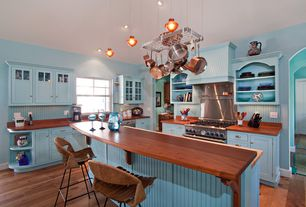 Traditional Kitchen with Wall Hood, Flat panel cabinets, Breakfast bar, Wood counters, dishwasher, partial backsplash
