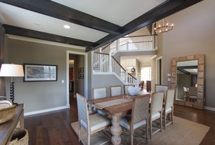 Traditional Dining Room with Crown molding, Chandelier, Hardwood floors, can lights, Cathedral ceiling, Exposed beam