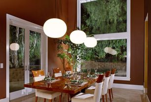 Modern Dining Room with Crown molding, French doors, simple marble floors, Hive glo ball pendant lamp, Pendant light