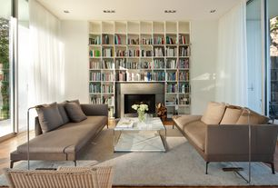 Contemporary Living Room with stone fireplace, Hardwood floors, Built-in bookshelf