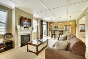 Traditional Great Room with stone fireplace, Hardwood floors, Built-in bookshelf, Carpet, flush light, Crown molding