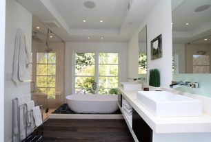 Contemporary Master Bathroom with Apaiser seascapes freestanding stone bathtub, frameless showerdoor, Double sink