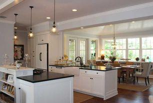 Traditional Kitchen with Soapstone counters, Pottery barn hundi lantern, Flat panel cabinets, Pendant light, Crown molding