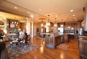 Craftsman Great Room with Columns, Wall sconce, Pendant light, Built-in bookshelf, stone fireplace, Hardwood floors