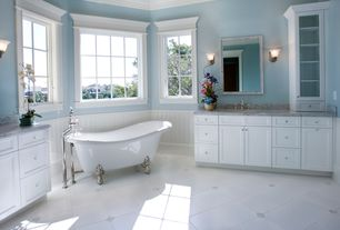 Traditional Master Bathroom with Complex Marble, Standard height, Crown molding, Master bathroom, Bathtub, Wall sconce, Flush