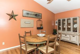 Country Dining Room with Ethan Harper Antique Fork Canvas Print, Rustic Metal Star, Ceiling fan, Hardwood floors