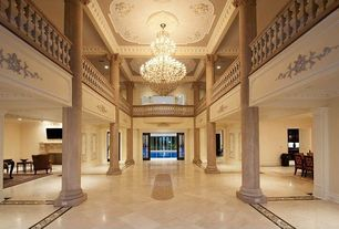 Traditional Entryway with High ceiling, Columns, sandstone tile floors, Loft, Chandelier, French doors