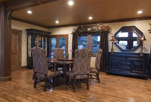 Eclectic Dining Room with Crown molding, Exposed beam, Laminate floors, French doors