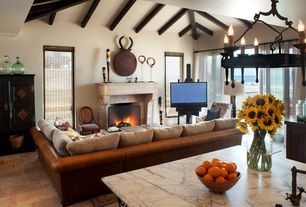 Mediterranean Living Room with Exposed beam, Cathedral ceiling, Built-in bookshelf, Cement fireplace, Concrete tile