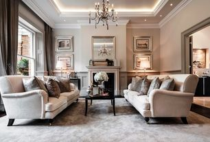 Traditional Living Room with Paint1, Standard height, Wainscotting, can lights, Chandelier, paint2, Cement fireplace, Carpet