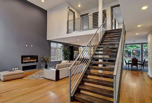 Contemporary Staircase with Floating staircase, Fireplace, Standard height, can lights, French doors, Laminate floors, Loft