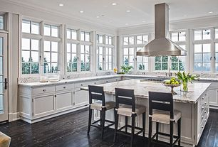 Traditional Kitchen with European Cabinets, Undermount sink, Transom window, French doors, Summit appliance island range hood