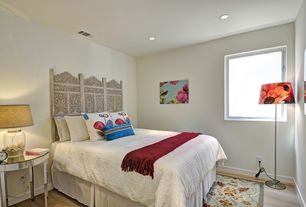 Guest Bedroom with Hardwood floors