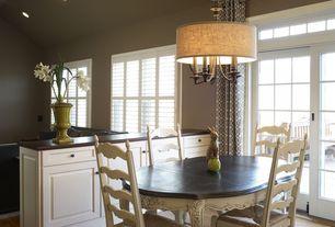 Modern Dining Room with Built-in bookshelf, French doors, Hardwood floors, flush light, Standard height, Transom window