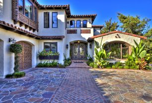 Mediterranean Front Door with Natural stone floors, Glass panel door, Pathway, exterior tile floors, Arched doorway
