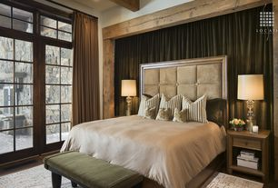 Rustic Master Bedroom with Hardwood floors, Transom window, Exposed beam, sliding glass door, High ceiling