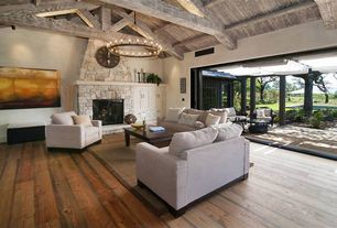"""Rustic Living Room with stone fireplace, Chandelier, Hardwood floors, Exposed beam, Camino round chandelier 38"""" - forged iron"""