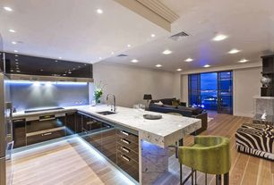 Contemporary Kitchen with European Cabinets, Breakfast bar, Crown molding, Stainless Steel, Complex marble counters, Balcony