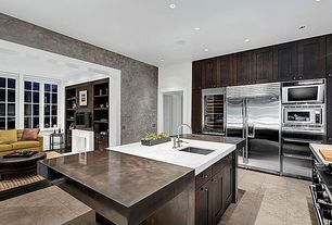 Contemporary Kitchen with Kitchen island, Flat panel cabinets, Undermount sink, limestone tile floors, Flush, L-shaped