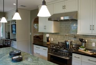 Traditional Kitchen with Flat panel cabinets, Soapstone counters, Kitchen island, New Yorker 1 Light Mini Pendant by Canarm